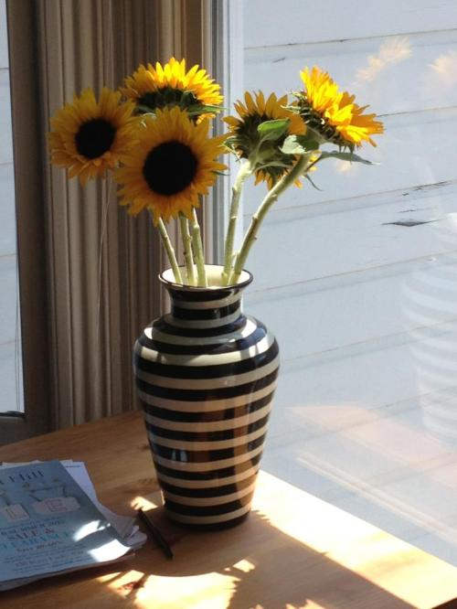 black and white striped vase with sunflowers